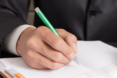 Businessman makes notes to his diary Royalty Free Stock Photos