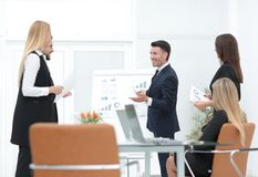 Businessman makes a presentation to his business team Stock Photo