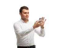 Businessman makes selfie using phone Stock Image