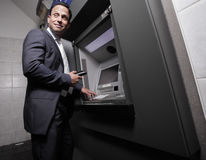 Free Businessman Making A Withdrawal Royalty Free Stock Photos - 14298438