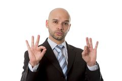 Businessman making all right sign with fingers in work success concept Stock Images