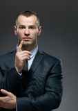 Businessman making attention gesture Stock Photo