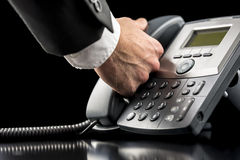 Businessman making a call on a landline Stock Photos