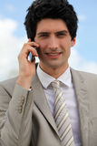 Businessman making a call outdoors Stock Photography