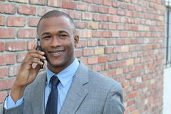 Businessman making a call outside Stock Photos