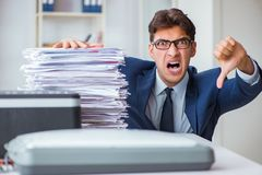 The businessman making copies in copying machine. Businessman making copies in copying machine royalty free stock images