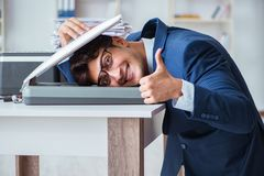 The businessman making copies in copying machine. Businessman making copies in copying machine stock photography