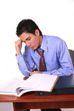 Businessman making decisions. Businessman studying differents documents to make important decisions Stock Photo