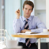 A businessman making a diary appointment Royalty Free Stock Photography