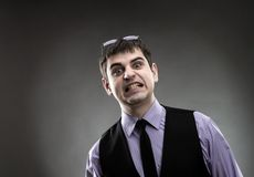 Businessman making faces Royalty Free Stock Image