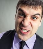 Businessman making faces Stock Photography
