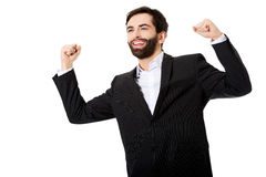 Businessman making fists in a winner gesture. Stock Photo