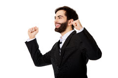 Businessman making fists in a winner gesture. Stock Images
