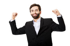 Businessman making fists in a winner gesture. Stock Photos