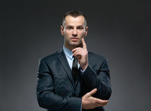 Businessman making forefinger gesture Stock Photography