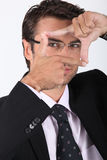 Businessman making a frame Royalty Free Stock Image