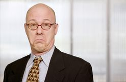Businessman making a funny face Stock Image