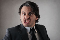 Businessman making funny face Stock Images