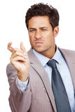 Businessman making hand gesture Stock Photography