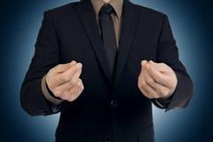 Businessman making a hand gesture Stock Photos