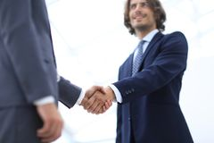 Close up image of business handshake at meeting. Royalty Free Stock Image
