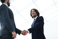 Close up image of business handshake at meeting. Businessman making handshake - success, dealing, merger and acquisition concepts Royalty Free Stock Image