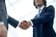 Close up image of business handshake at meeting. Royalty Free Stock Photos