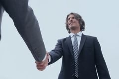 Close up image of business handshake at meeting. Businessman making handshake - success, dealing, merger and acquisition concepts Royalty Free Stock Photos
