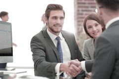 Introduce new member of the working team. Businessman making handshake - success, dealing, merger and acquisition concepts stock images