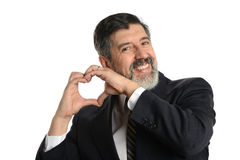 Businessman making a heart gesture Royalty Free Stock Image