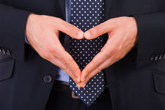 Businessman making heart symbol with hands. Stock Photography