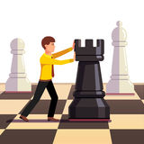 Businessman making move on a business chessboard. Businessman making his move on a business chessboard. Flat style vector illustration Stock Photo