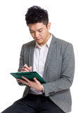Businessman making note on clipboard Stock Photography