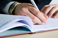 Businessman making notes Stock Image
