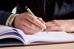 A businessman making notes Stock Images