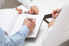 Businessman making notes in a datebook Stock Photo