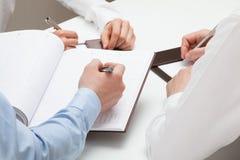 Businessman making notes in a datebook. Closeup shot Stock Photo