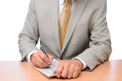 Businessman Making Notes on Newspaper Royalty Free Stock Images