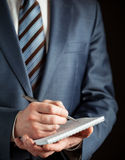 Businessman making notes on the paper Stock Photography