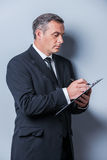 Businessman making notes. Royalty Free Stock Photography