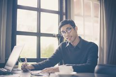 Businessman making notes while working at office stock photography