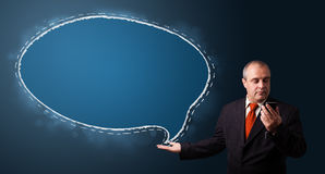 Businessman making phone call and presenting speech bubble copy Royalty Free Stock Photography