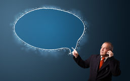 Businessman making phone call and presenting speech bubble copy Stock Photo