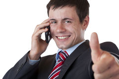 Businessman making a phone call showing thumb up Royalty Free Stock Photos