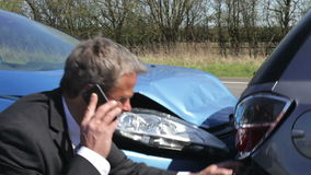 Businessman Making Phone Call After Traffic Accident stock video footage