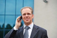 Businessman making phonecall. Close up of a businessman making a phonecall outside Stock Image