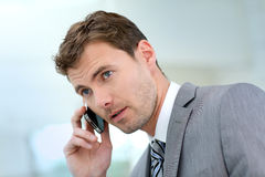 Businessman making a phonecall Royalty Free Stock Image