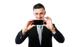 Businessman making photo with his cellphone Stock Photography