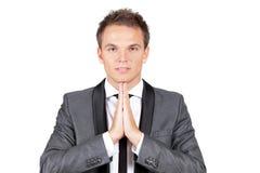 Businessman making a prayer Stock Photo