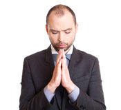Businessman making a prayer. Stock Photography